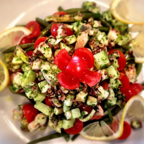Octopus salad with potatoes, green beans and tomatoes