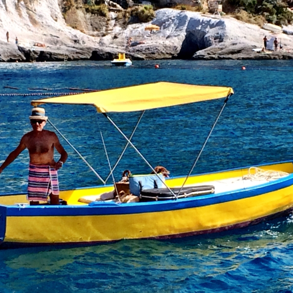 Ponza local: The most relaxed guy on the planet is also boating good times with his 2 dogs, picnic basket and guitar